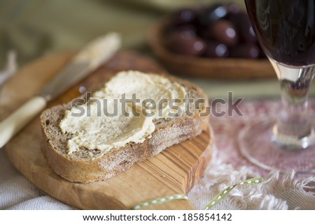 Creamy hummus spread on healthy whole wheat toast - stock photo