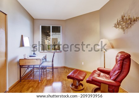 Creamy office room interior with deck and comfortable chair with foot rester - stock photo