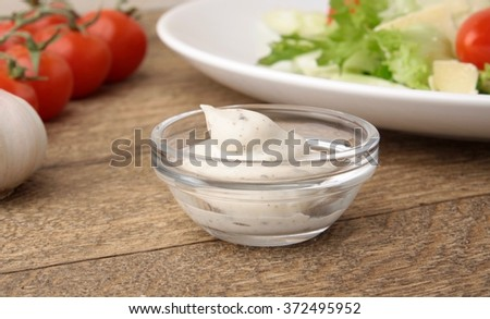 Creamy onion dressing salad - stock photo