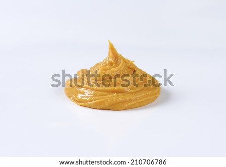 Creamy peanut butter in a bowl - stock photo