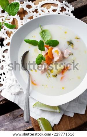 Creamy salmon soup in finnish style - stock photo