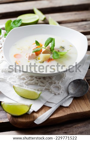 Creamy salmon soup in finnish style - stock photo