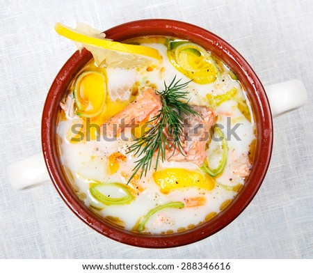 Creamy salmon soup (lohikeitto in Finnish, laxsoppa in Swedish) is a common dish in Finland and other Nordic countries. - stock photo