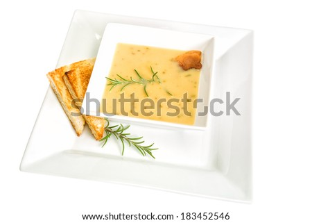 Creamy soup from dried yellow peas with rosemary - stock photo