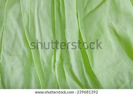 creased fabric background in green color