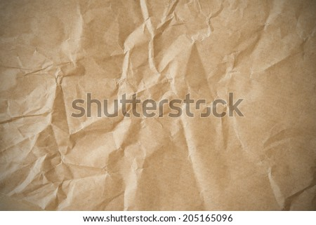 Creased paper background vignette - stock photo