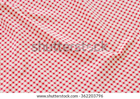 Creased red and white cloth material fragment as a background
