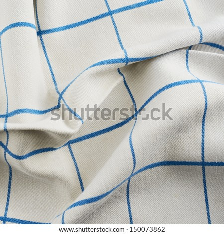 Creased tablecloth cloth fragment as abstract texture - stock photo