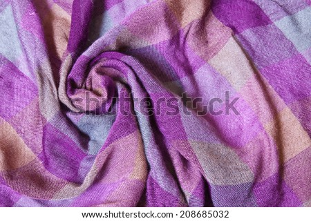 Creasing machine woven textile fabric in yellow - purple and blue plaid - stock photo