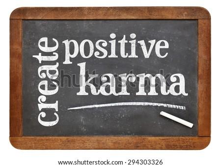 create positive karma - motivational text on a vintage slate blackboard - stock photo