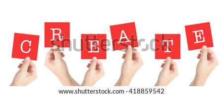 Create written on cards held by hands - stock photo