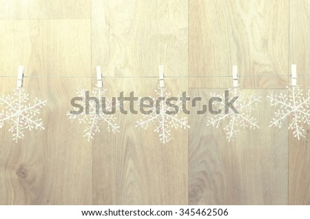 creating christmas decoration indoor. christmas background with snowflakes - stock photo