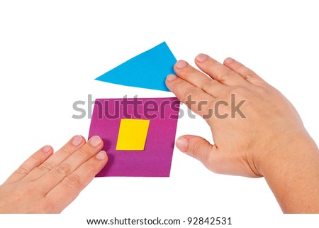 Creating home of colored paper on a white background