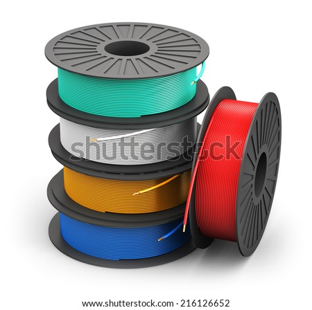 Creative abstract electricity and technology engineering industrial business concept: plastic spools with color electric copper power cables isolated on white background - stock photo