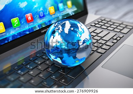 Creative abstract global computer communication and internet business telecommunication concept: macro view of crystal Earth globe on laptop or notebook keyboard with selective focus effect - stock photo