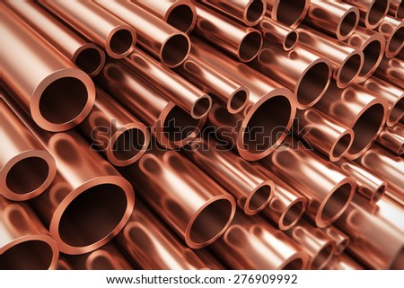 Creative abstract heavy non-ferrous metallurgical industry and industrial manufacturing business production concept: heap of shiny metal copper pipes with selective focus effect - stock photo