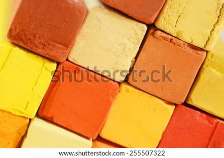 Creative art background - closeup of bright pastel crayons with yellow,orange,red and ochre colours  - stock photo