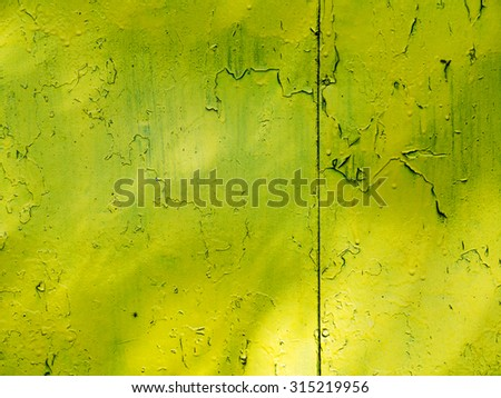 Creative background of rusty metal, painted gray paint carelessly with the remnants of torn paper. Grungy metal surface. Great background or texture for your project. - stock photo
