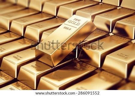 Creative banking, financial success development, growth and profit investment concept: macro view of stacks and rows of gold ingots or golden bullions bars with selective focus effect - stock photo