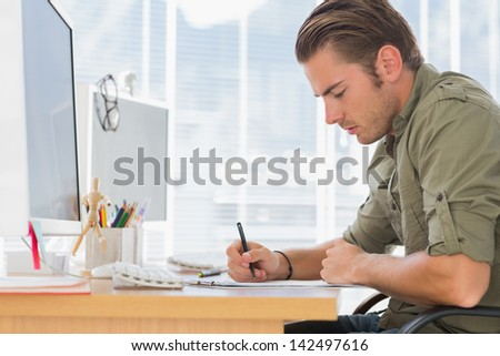 Creative business employee working in a modern office - stock photo
