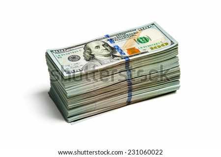 Creative business finance making money concept - large stack of new 100 US dollars 2013 edition banknote bills isolated on wooden background