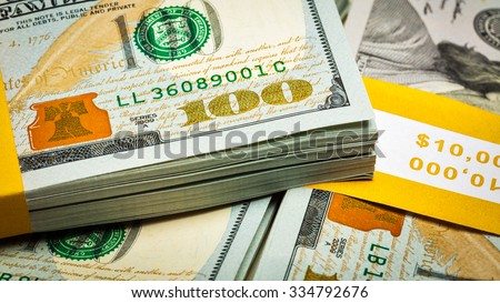 Creative business finance making money concept - panoramic image of new 100 US dollars 2013 edition banknotes (bills) bundles close up - stock photo
