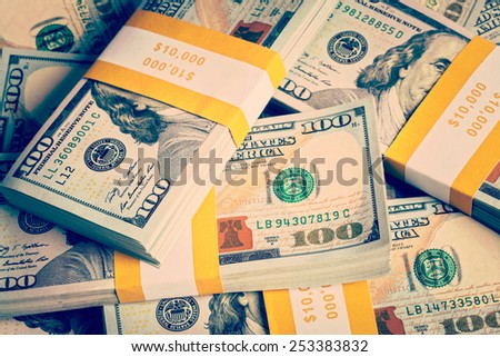Creative business finance making money concept - Vintage retro effect filtered hipster style image of background of of new 100 US dollars 2013 edition banknotes (bills) bundles close up - stock photo
