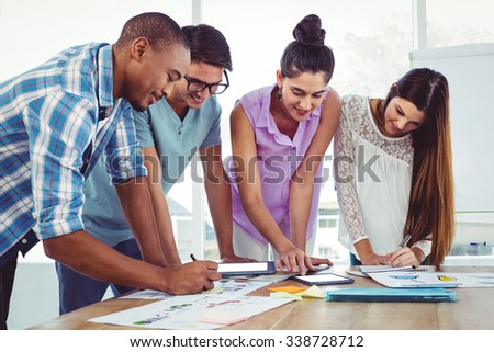 Creative business team at meeting in casual office - stock photo