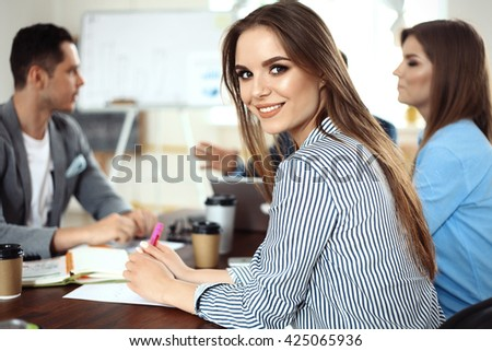 Creative business team working hard together in casual office