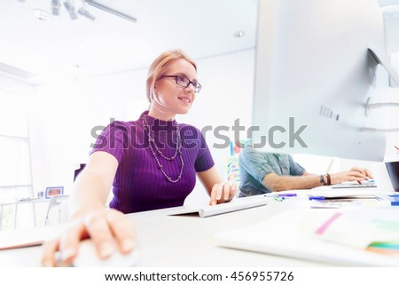Creative business woman in office - stock photo