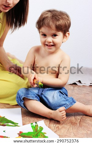 Creative child or Painting, Clever child, Happy child, Smiling boy, Art school, Art studio, Creative process, Positive thinking - stock photo