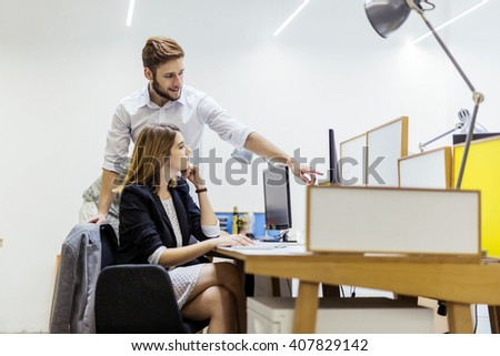 Creative colleagues working on a desktop  in a modern office - stock photo