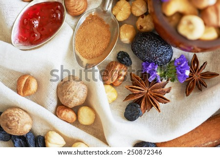 creative composition a mix of different nuts on the tablecloth with decorative elements