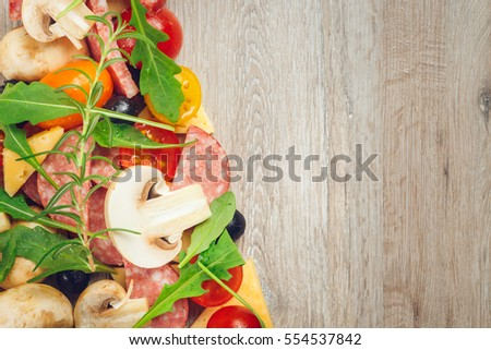 Creative composition of ingredients in the form of a slice of pizza