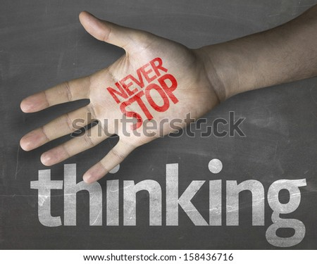 """Creative composition with the message """"Never Stop Thinking"""" - stock photo"""