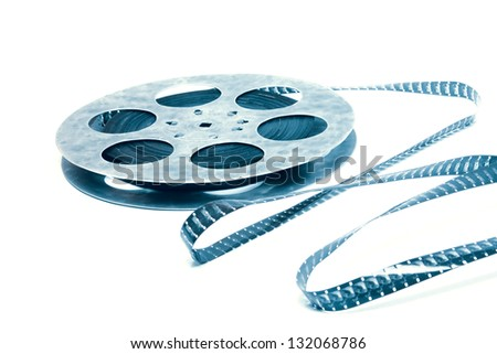 Creative concept of a retro movie celluloid film with a vintage film reel - stock photo