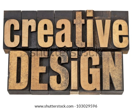 creative design - creativity concept - isolated text in vintage letterpress wood type - stock photo
