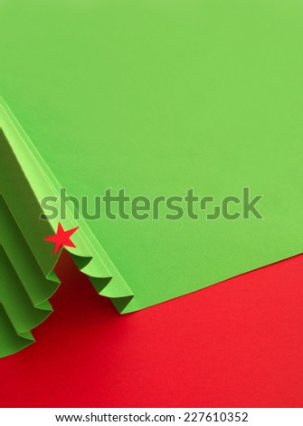 Creative design of christmas background with paper fir tree - stock photo