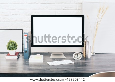 Creative designer desktop with blank white computer monitor, keyboard, stationery items, decorative plants and blank picture frames on white brick wall background. Mock up - stock photo