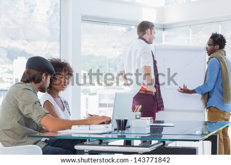Creative designers working in a bright modern office - stock photo