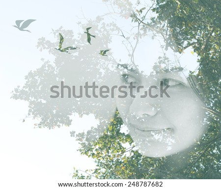 Creative double exposure portrait of young Asian woman combined with photograph of nature. Flying birds from human head. Concept about freedom.