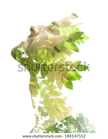 Creative double exposure portrait of young man combined with photograph of nature - stock photo