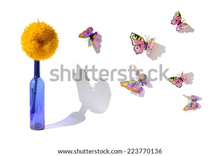 Creative edit with sunflower and artificial butterflies - stock photo