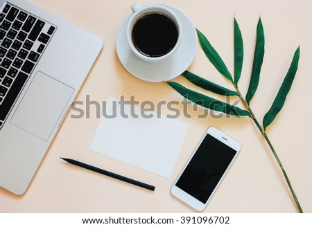 Creative flat lay photo of workspace desk with laptop, smartphone, coffee and blank paper with copy space background, minimal style - stock photo