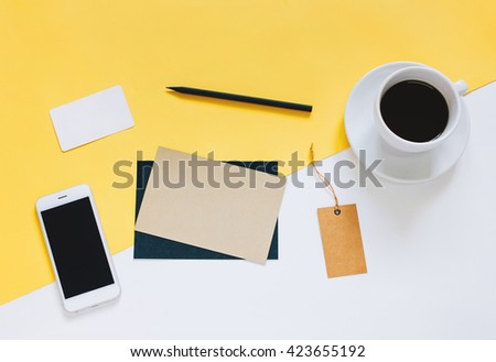 Creative flat lay photo of workspace desk with smartphone, coffee, tag and letter with copy space background, minimal styled - stock photo