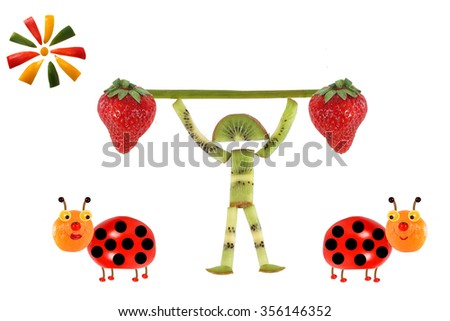 Creative food concept. Funny little boy  with slices of kiwi.  - stock photo