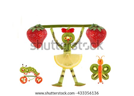 Creative food concept. Funny little girl  with slices of kiwi.  - stock photo