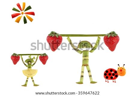 Creative food concept. Funny little people with slices of kiwi. - stock photo