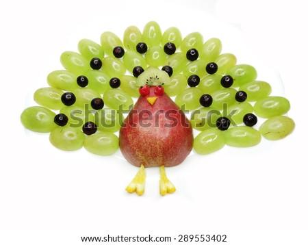 creative fruit dessert for child funny form peacock bird - stock photo