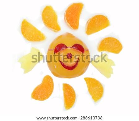 creative fruit dessert for child funny form sun in sunglasses - stock photo